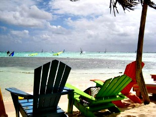 chairs with windsurf harness at jibe city hangout bar bonaire
